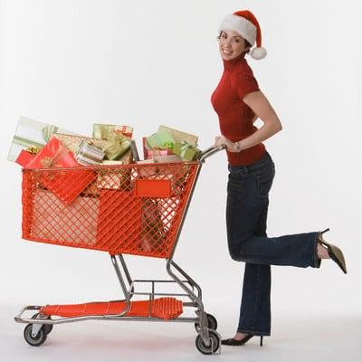 Woman pushing shopping cart of gifts